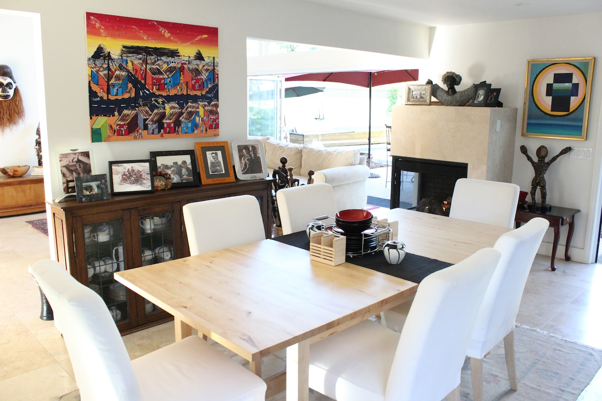 Dining room with fireplace and painting from South Africa