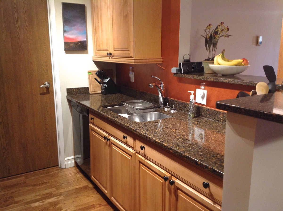 Galley kitchen with granite counter tops