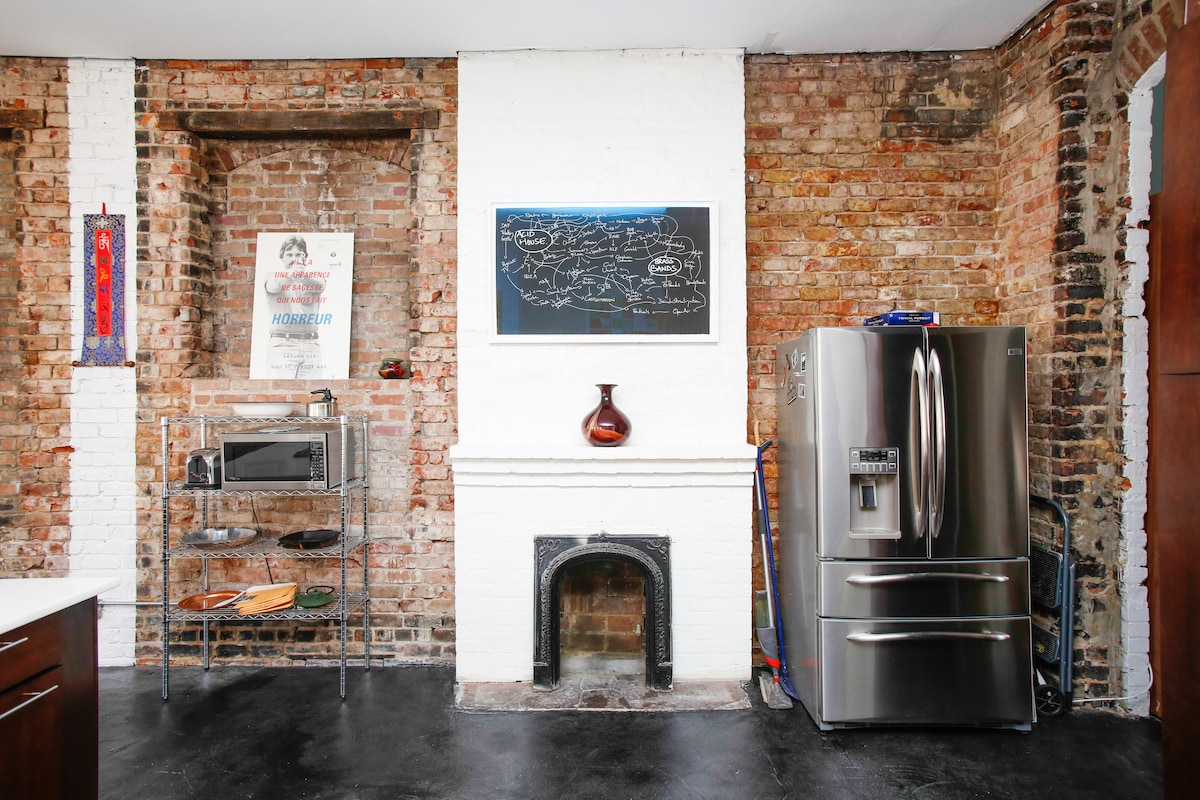 Historic fireplace in modern kitchen