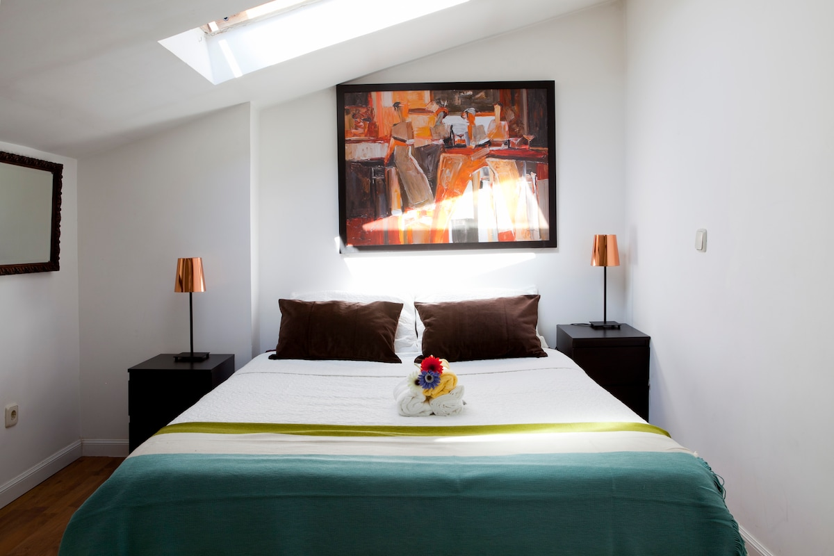 Double bed in the room upstairs