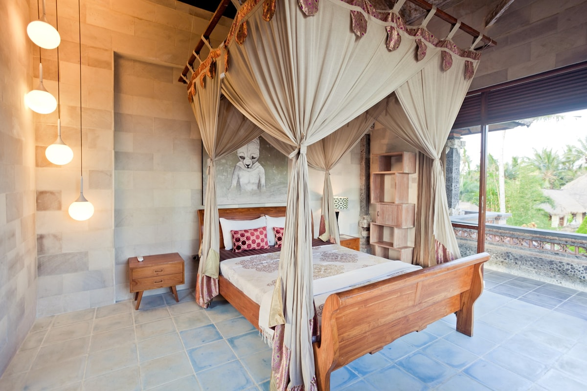 Upstairs bedroom facing sunset side with a antique bed with mosquito net