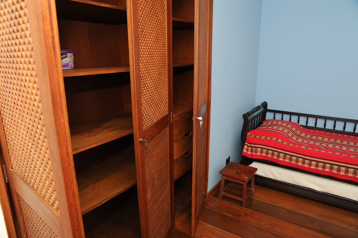 The bed and part of the cupboard