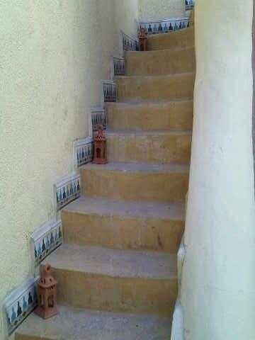 Escalier menant a la chambre rouge