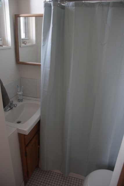 Although the bathroom is small, it has a small tub and shower, and a window.
