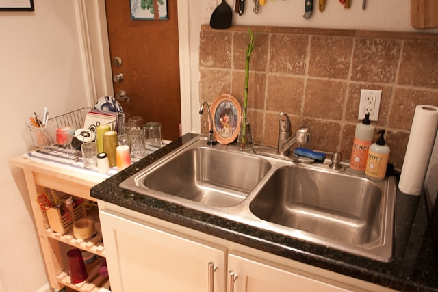 kitchen area-double basin sink w/ garbage disposal, filtered water on the left and full servicewear.