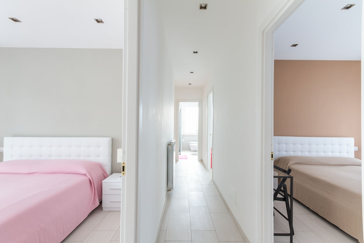 This is the long central corridor leading to the four rooms and the two bathrooms