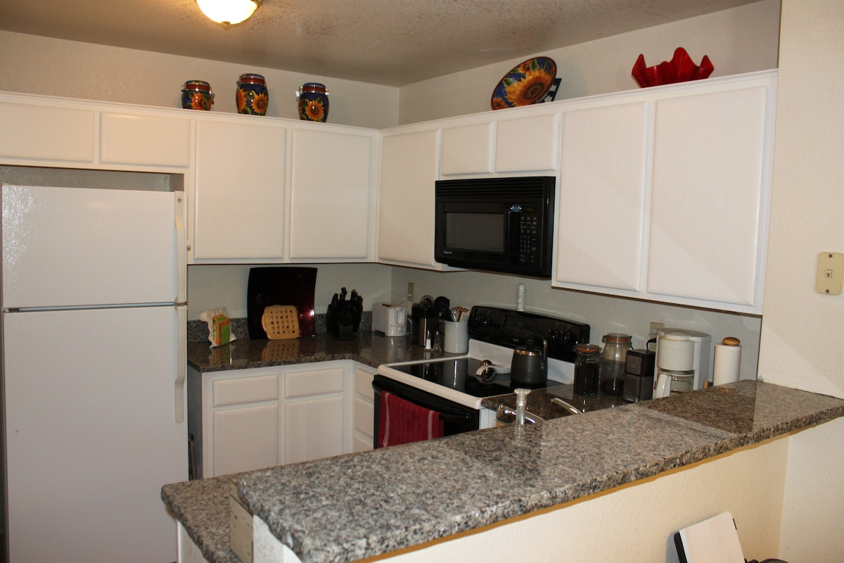 Kitchen with new counter tops, sink, and faucet.
