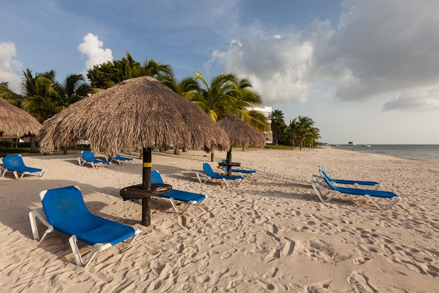 Beach with shaded loungers exclusively for Residencias Reef guests
