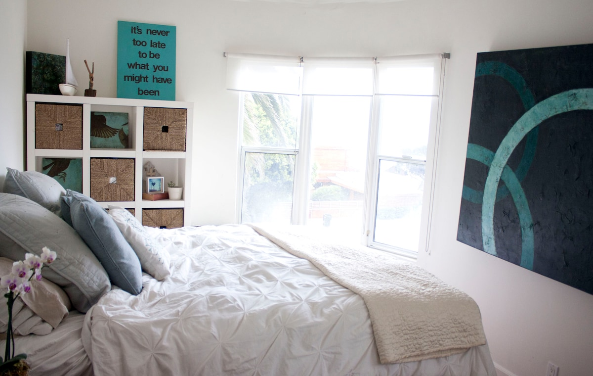 beachy modern bedroom with an ocean view and luxury pillow top king size bed...it's like sleeping on a cloud!