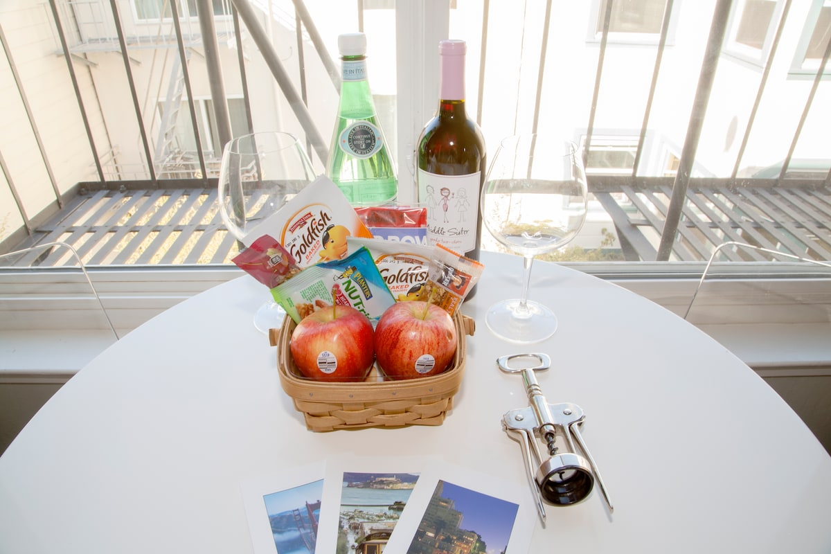 Complimentary bottle of wine, sparkling water and snack gift basket to greet you after your journey