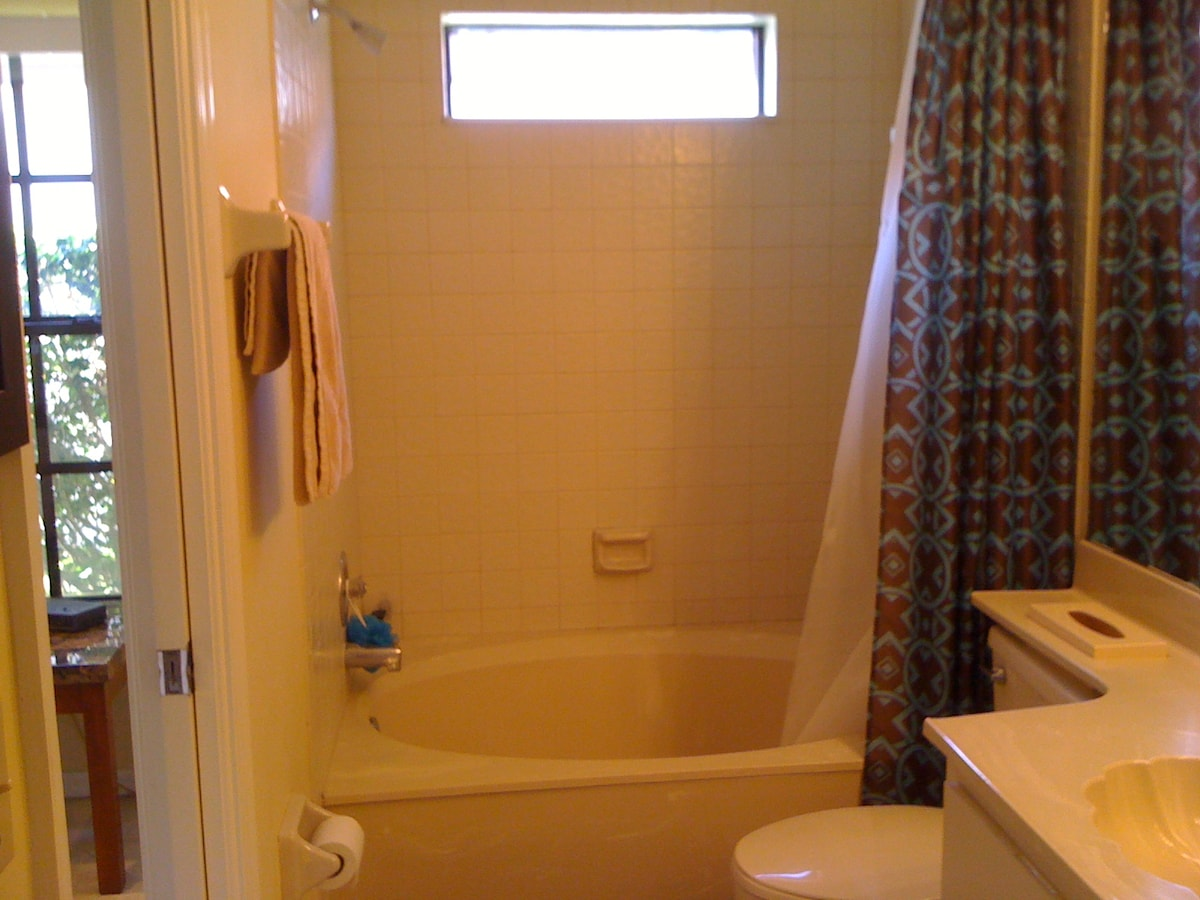 Full bath with roman tub and shower.