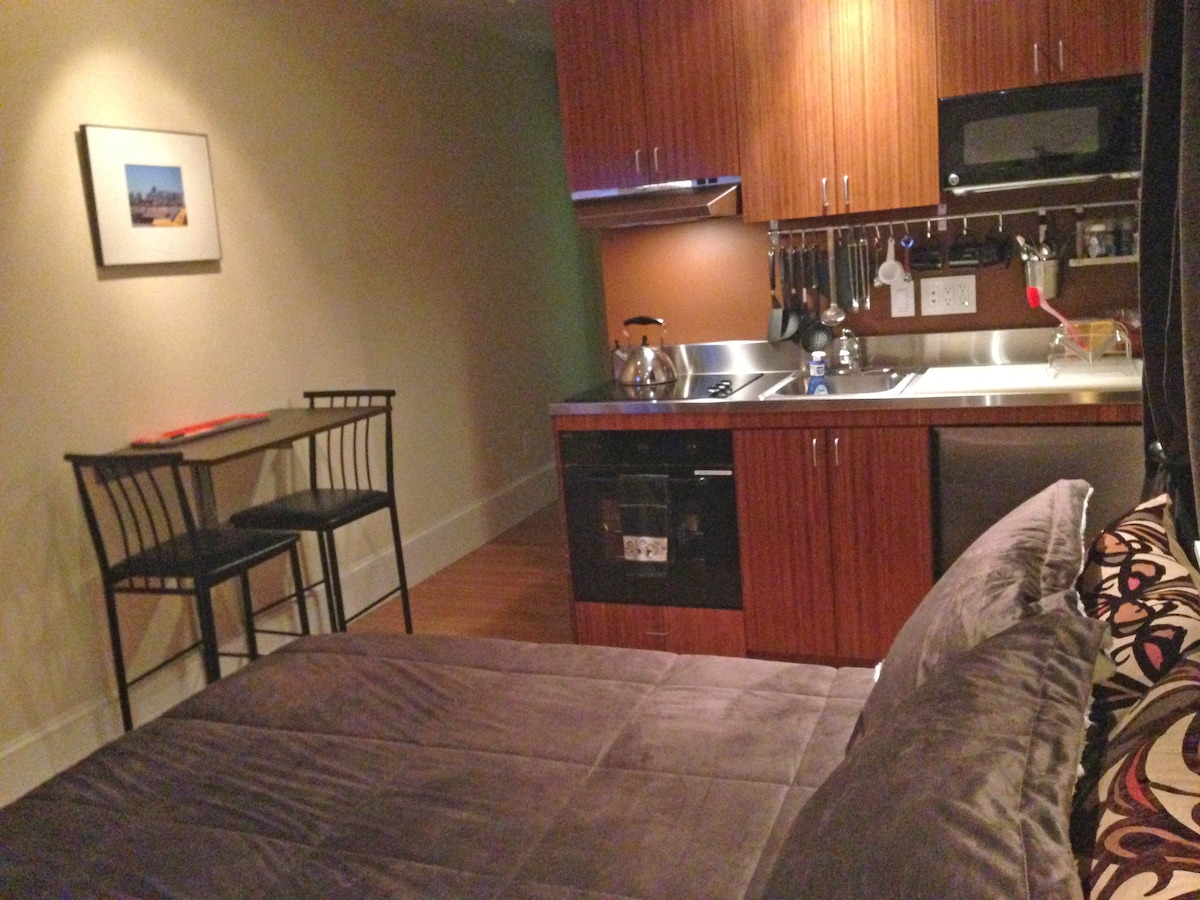 Kitchenette complete with oven, cooktop, garbage disposal, refrigerator and eating nook.