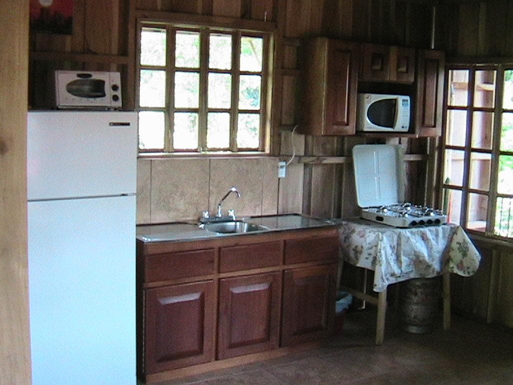 Kitchen with refrigerator and stove