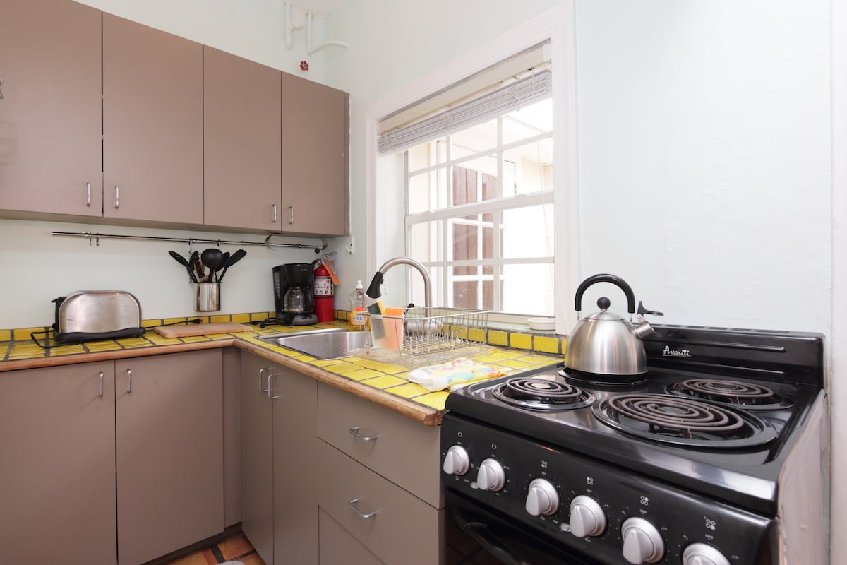 Kitchen with electric stove and range