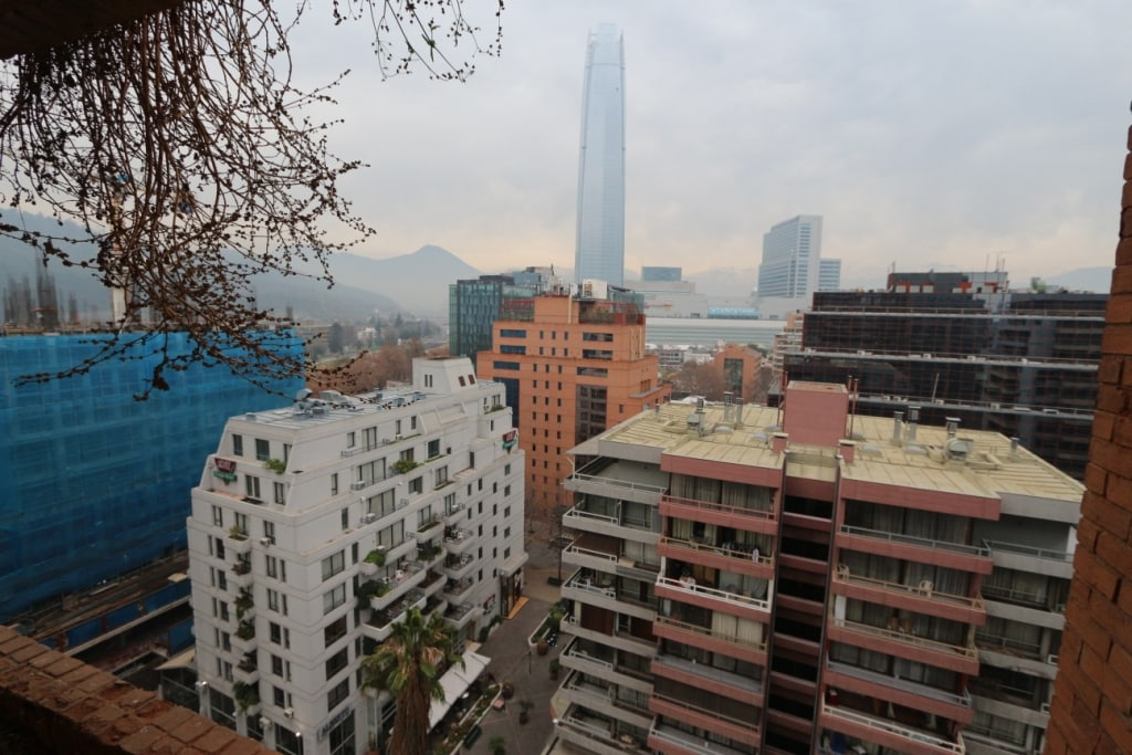 Sight of the Andes mountains. Big building is Costanera Center.