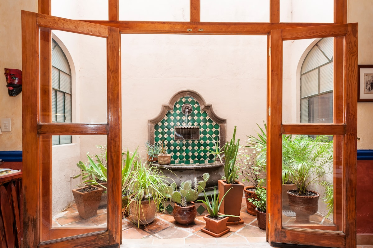 The fountain and plants.  Doors can be opened to have a full exposure in the living room