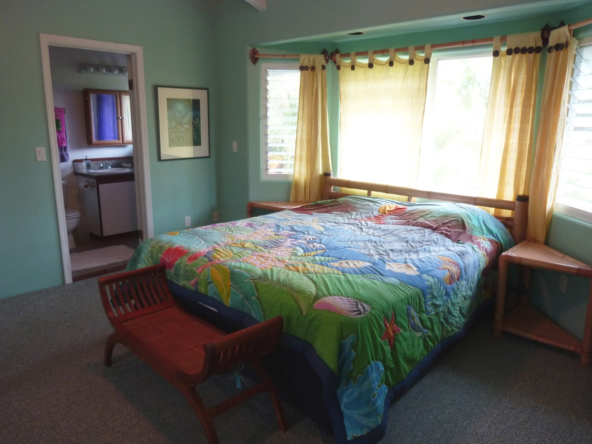 Large bedroom with Cal. King size bed and private custom full bathroom.