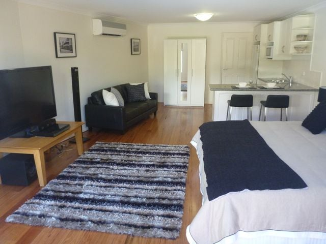 "Suite including King size bed, 55"" TV, Lounge and kitchenette."