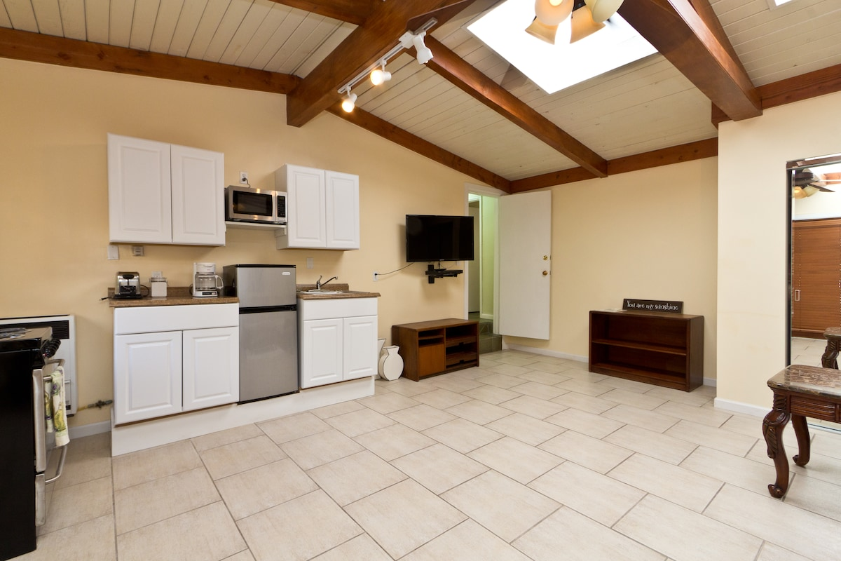 Living Room and Kitchenette with flat screen tv. coffee maker, blender , toaster, stove