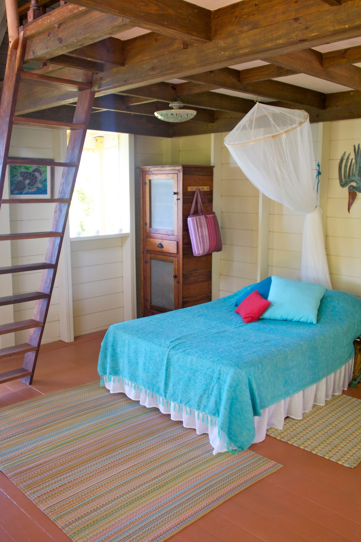 Main room - Full size bed with the ladder to reach up to the mezzanine