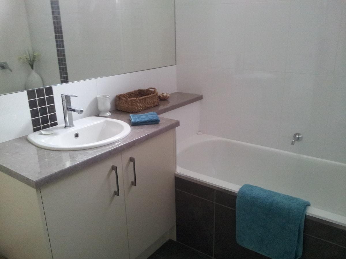 Bathroom vanity and bath