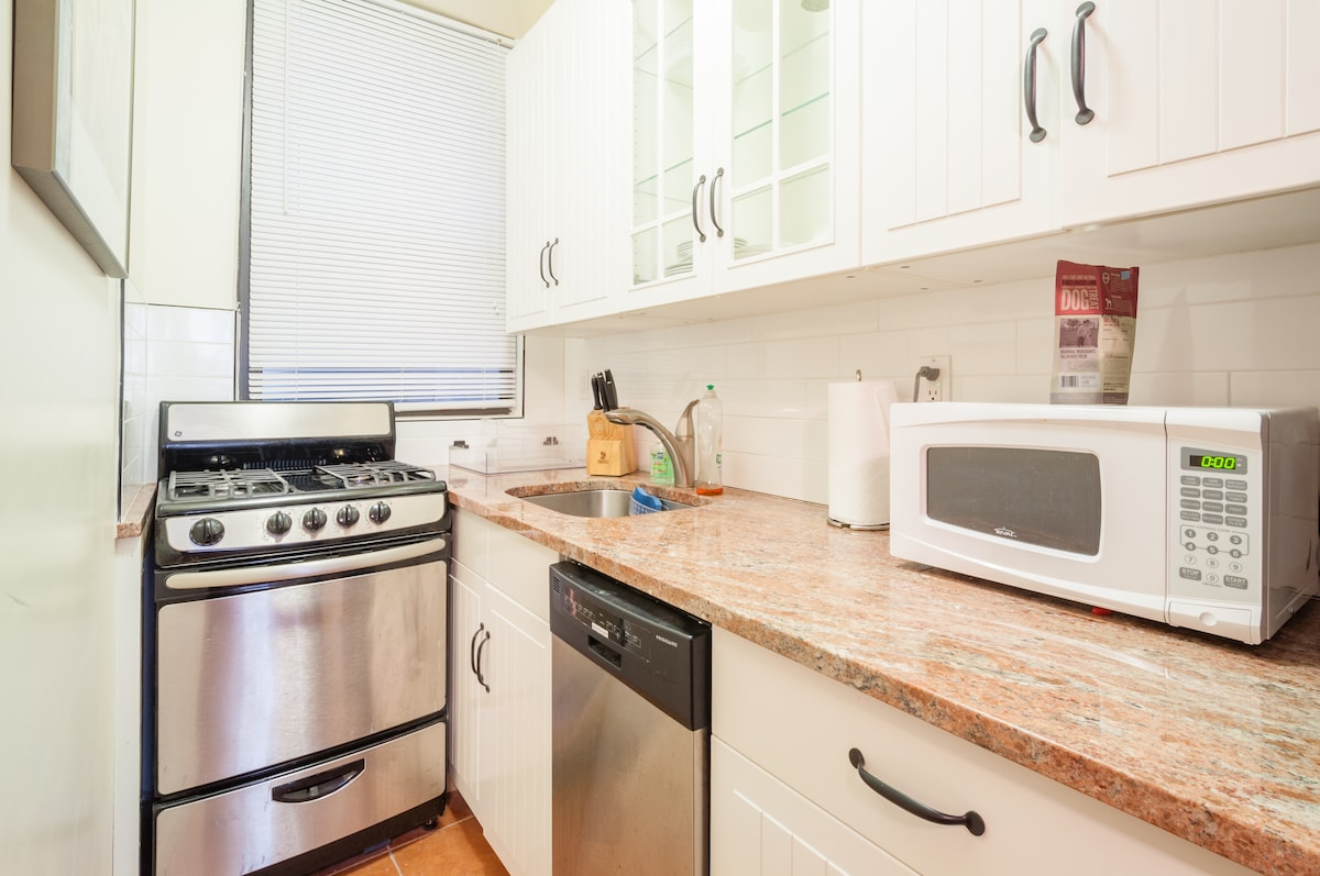 Granite kitchen top with microwave and appliances
