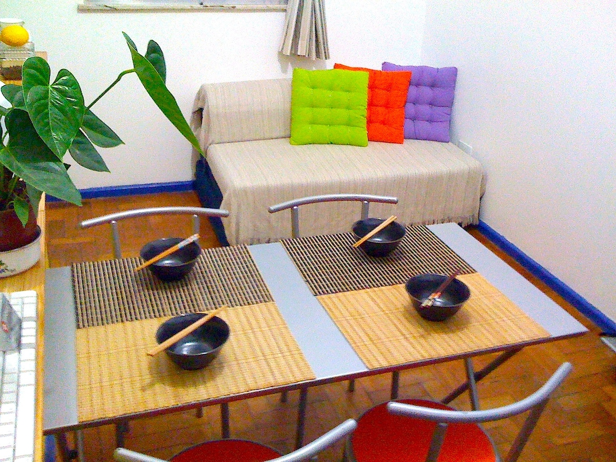Living/dining with the sofa that convert into a double bed - dining table set for four.