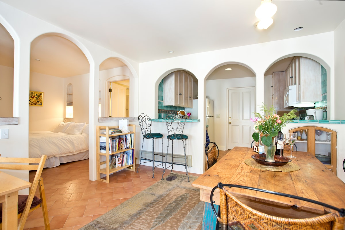 This shows the bedroom area and dining room. It has beautiful arches that create an open and spacious feeling