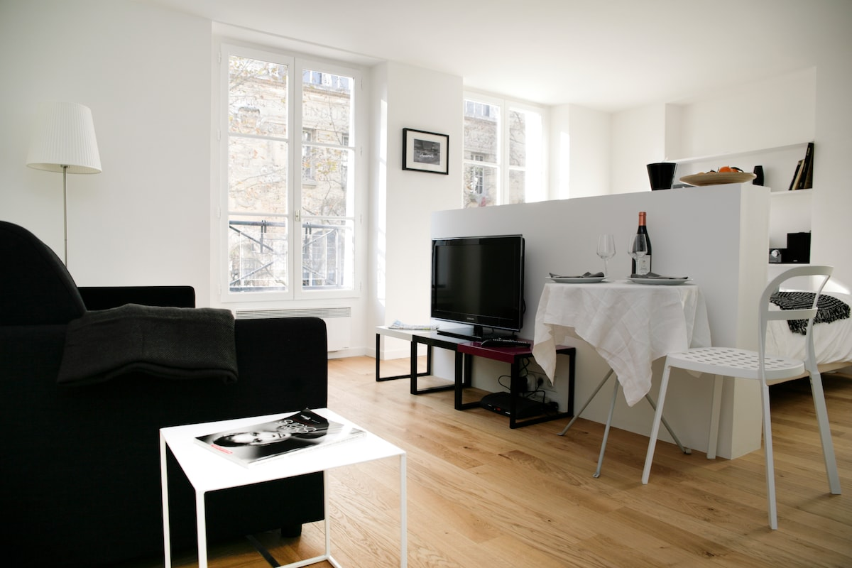 The studio has three wide windows with open outlook and is very bright, even in the winter