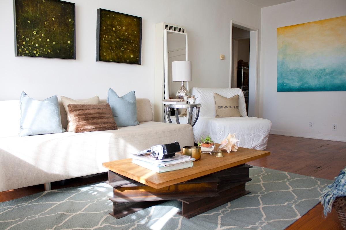 light filled modern living room filled with original artwork