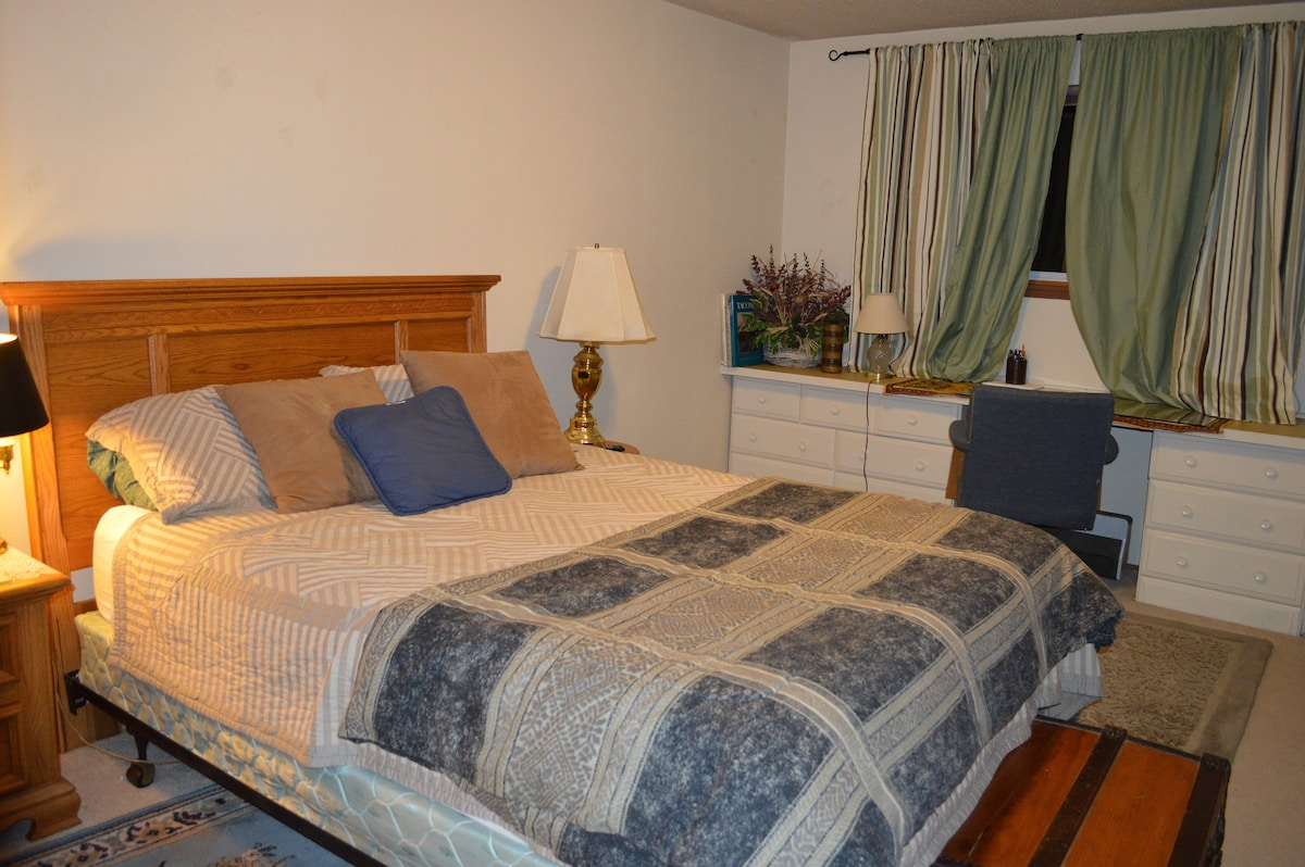 Guest quarters include Queen bed, built-in desk with some drawers available.