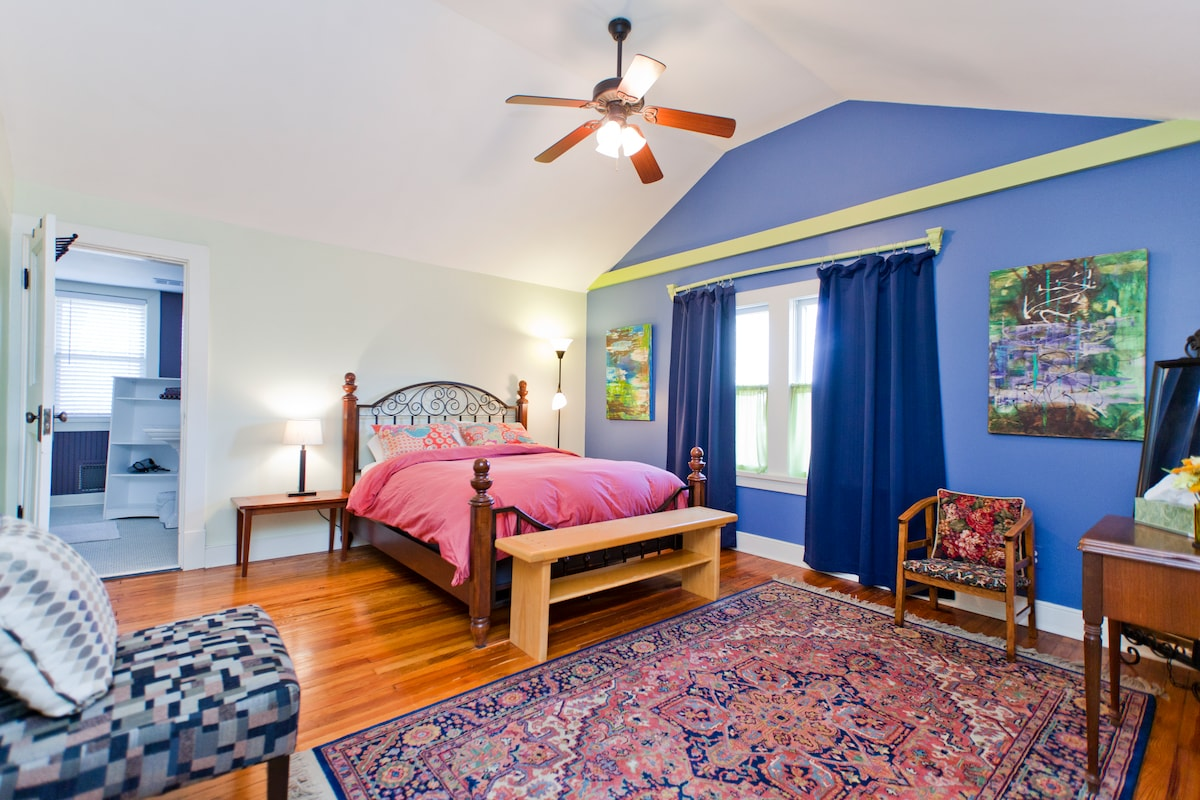 Large master bedroom with vaulted ceiling, overhead fan,  blackout drapes, attached bathroom, plenty of closet space.