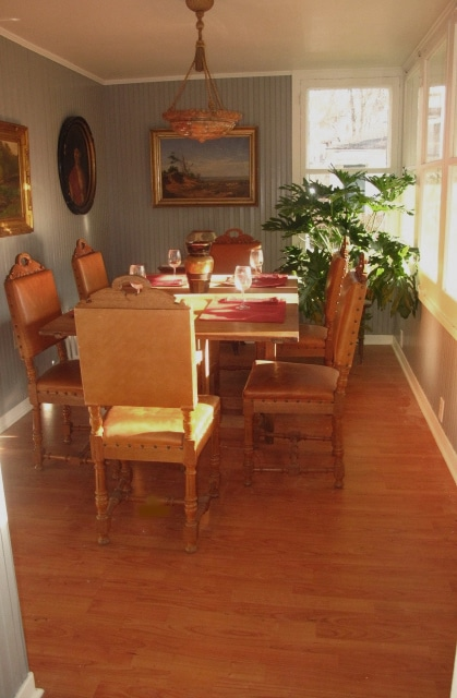 Dining Room with 19th  Century Swedish Table and Chairs and Fine Paintings