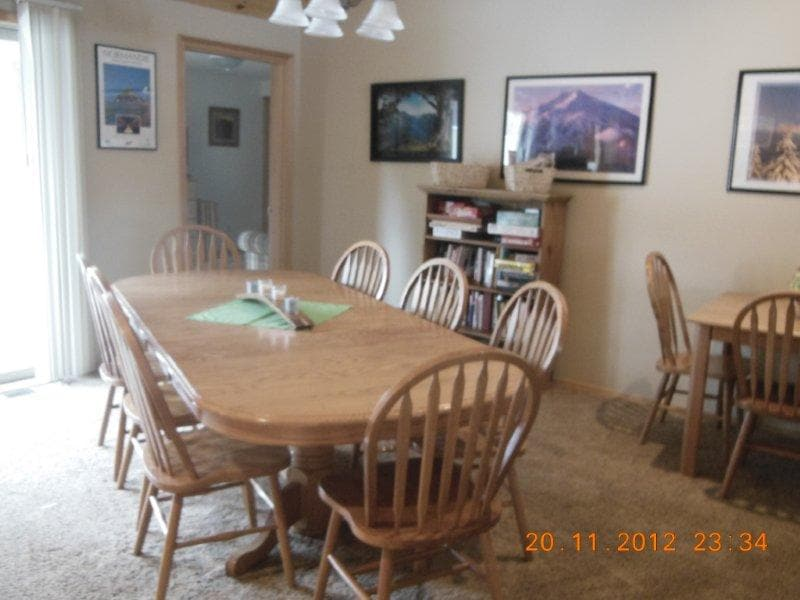 Large dining table is perfect for family dinners & games.