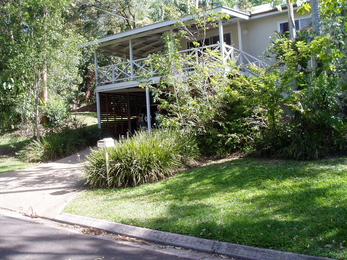 View from the street - downstairs apartment is hidden by the trees-entrance off carport