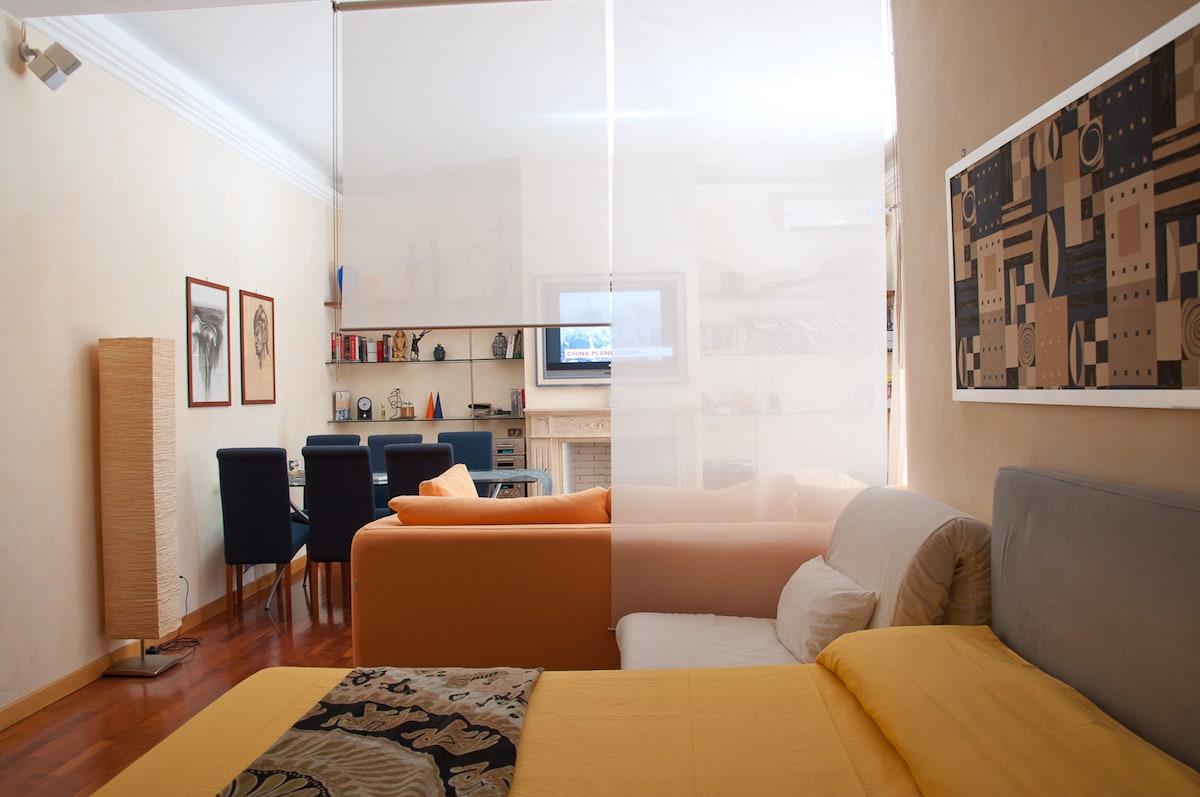 View of the open space from the bed.......with the white chair single bed.