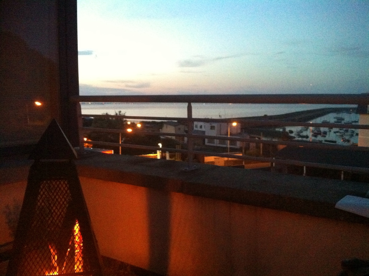 Firepit on the terrace looking out over harbour