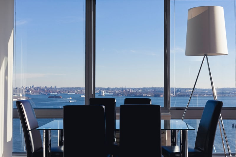 Dining Area with Floor-to-Ceiling Windows Overlooking the Hudson River and Downtown New York City