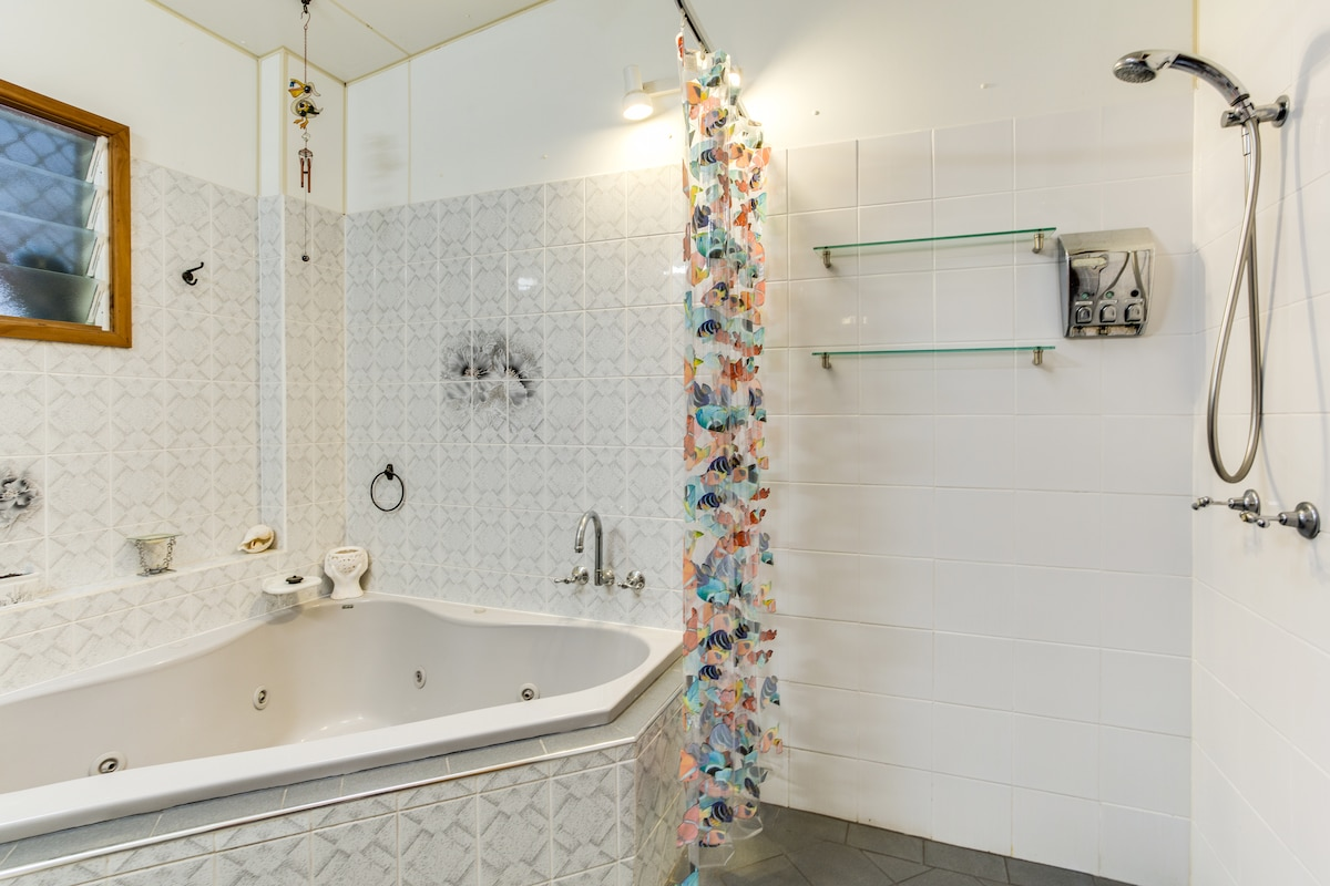 The spacious bathroom with a spa and shower....wheel chair access. This bathroom has complimentary shampoo, conditioner and shower gel for your use.