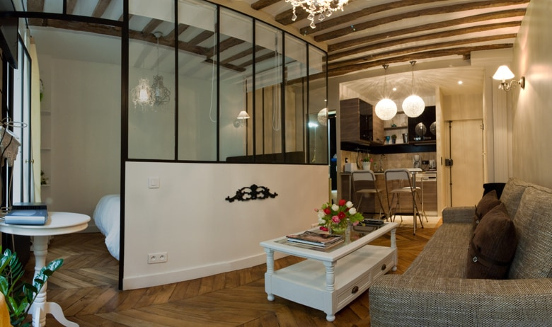 Bedroom is half separated with a glass structure. There are curtains for privacy of course