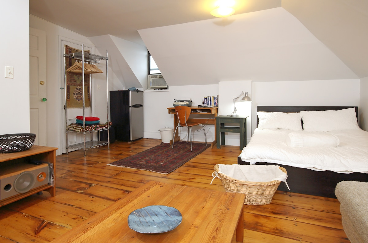 Large bedroom includes lounge area, cable TV and fridge