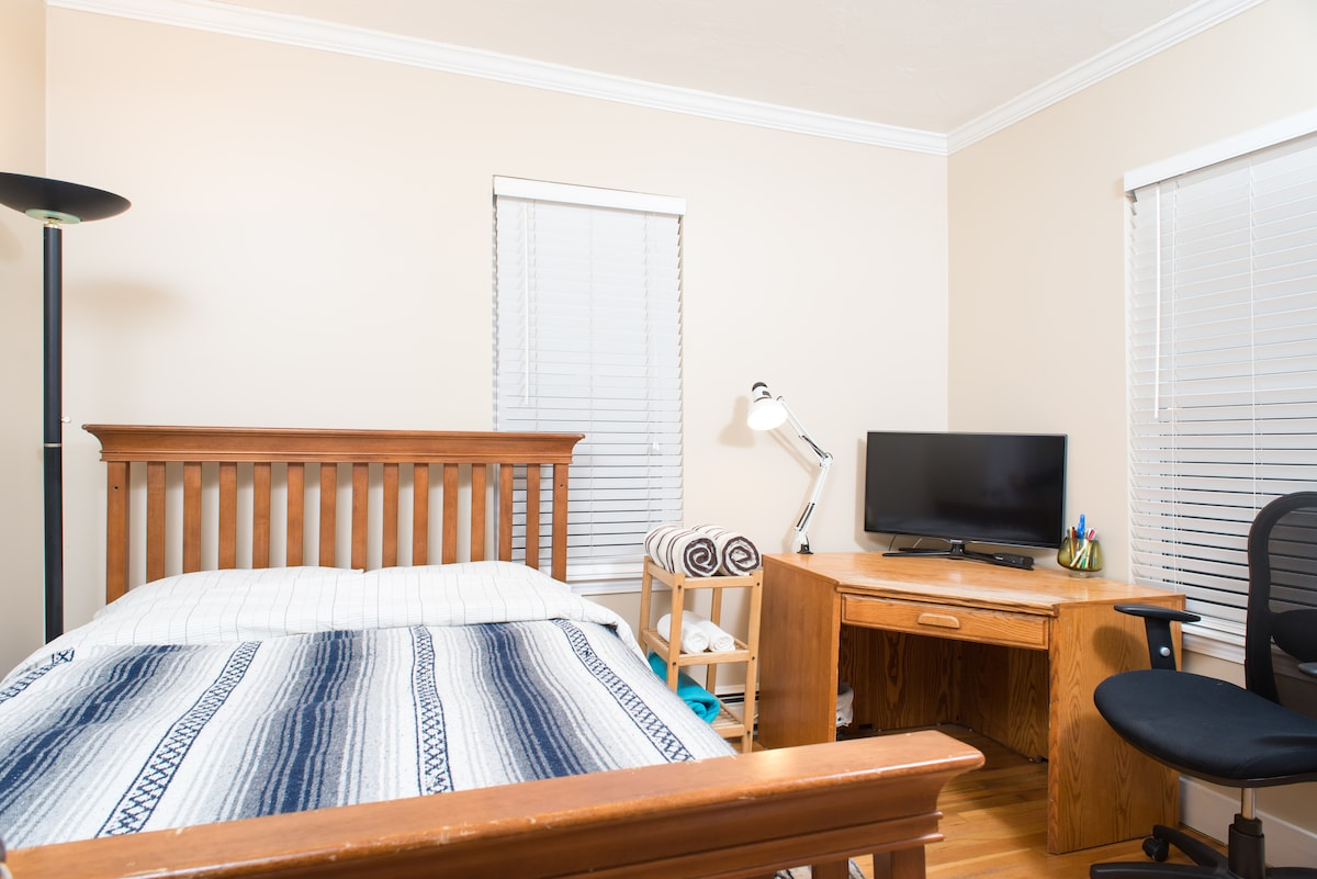 your cozy Airbnb room (full size bed, towels, desk and chair, web enabled HDTV, iron and board)