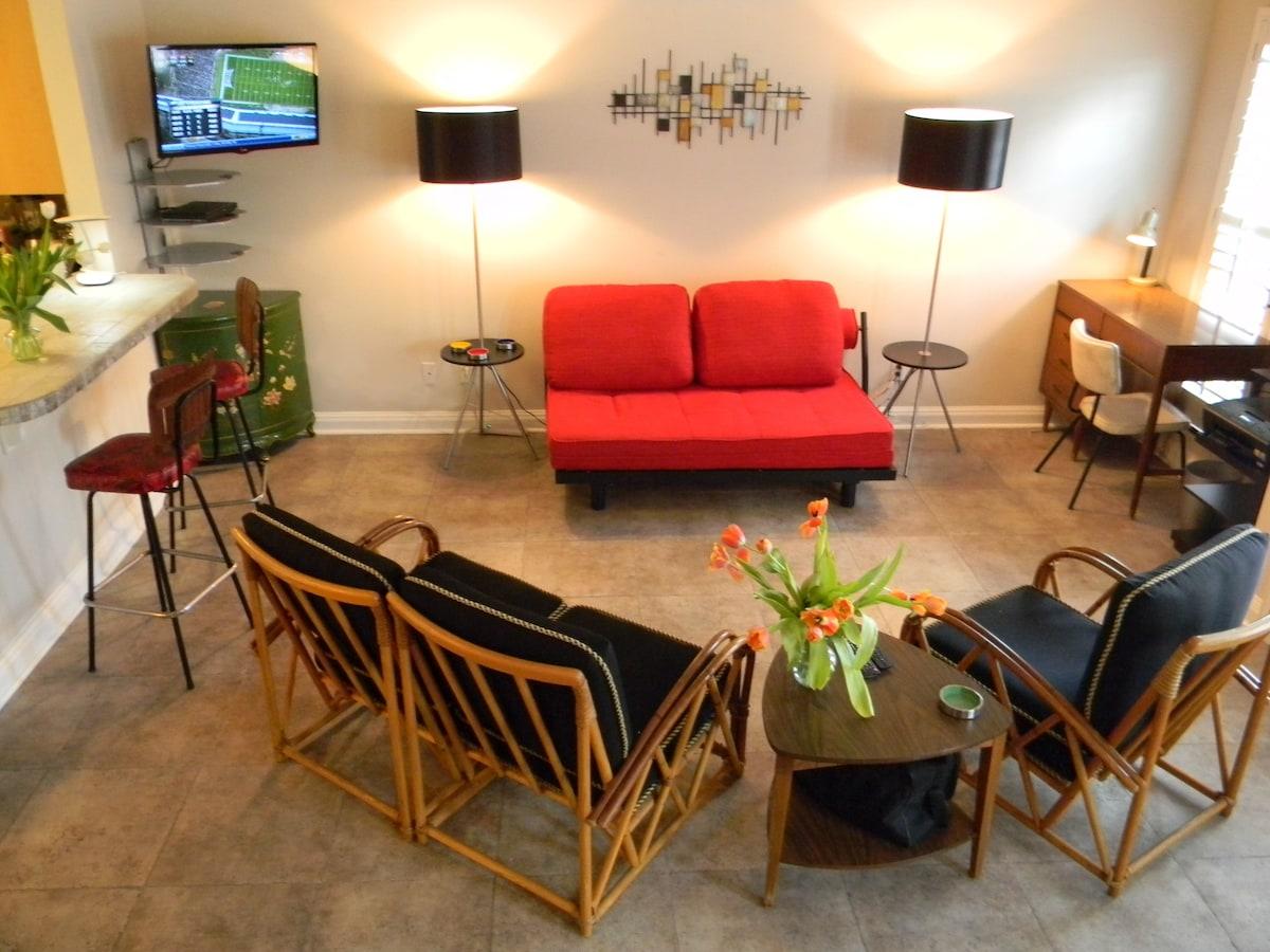 Your living room with bar, TV/DVD, sleeper sofa.  Desk, printer-copier-scanner.
