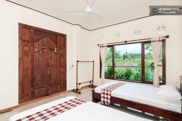 Two single beds, AC and an incredible door.