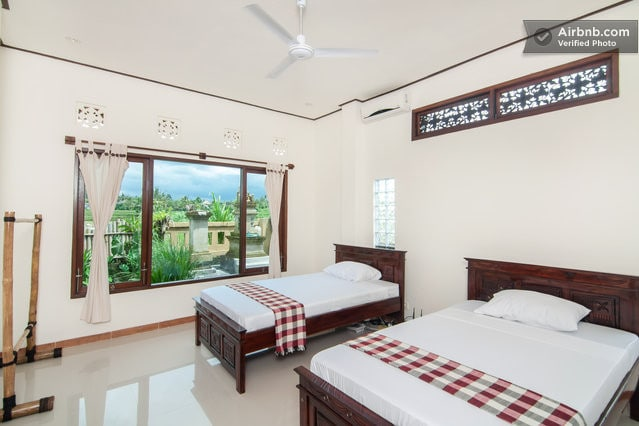 Twin room with bamboo furniture and a very green view.