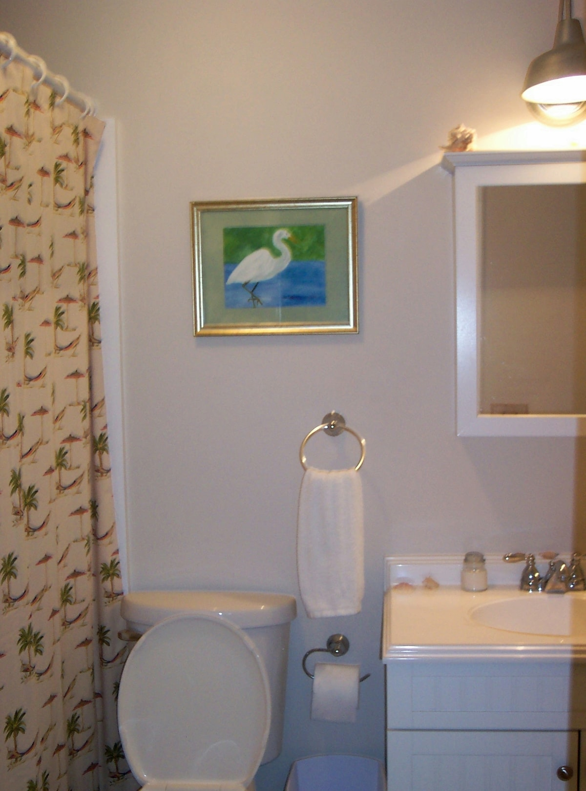 Full bath has deep garden tub and rain shower head, plenty of towels, + extra toiletries for guest's use. Washer dryer in hall closet
