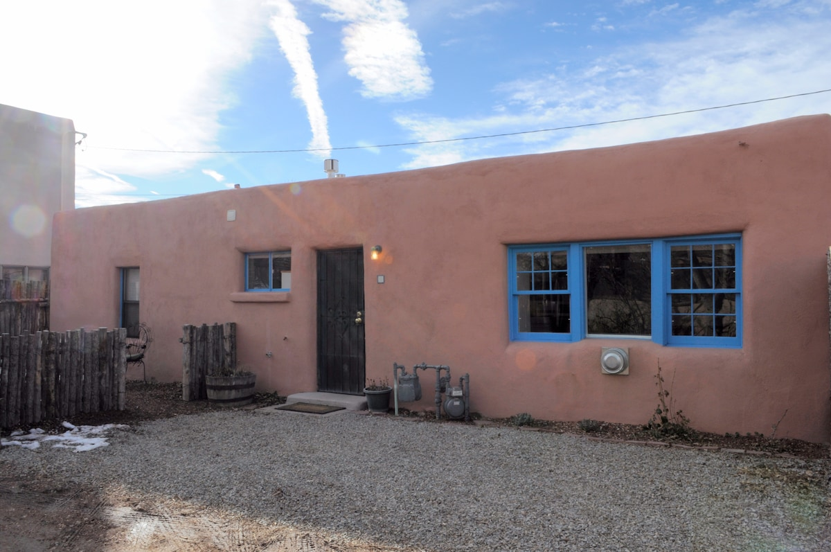 Santa Fe-style adobe house with traditional sky-blue trim