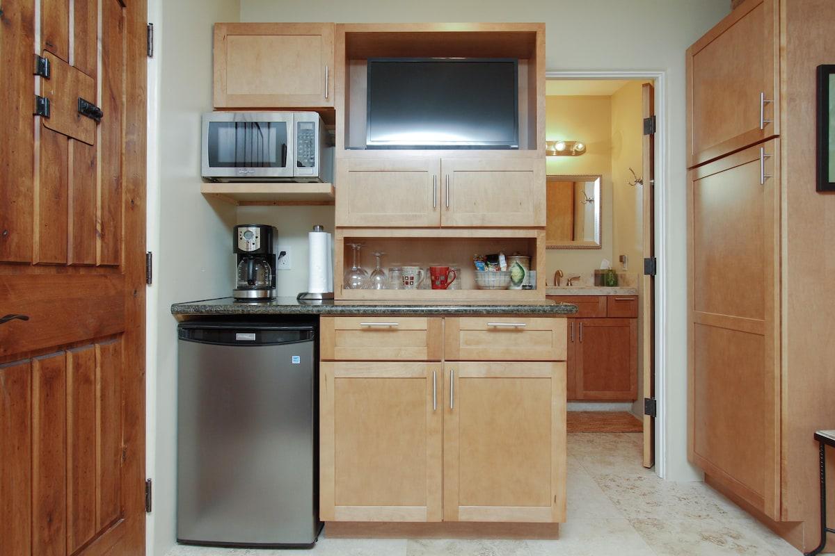 Flat Screen TV, Fridge, MIcrowave, Coffee Maker, Toaster, Tea Kettle