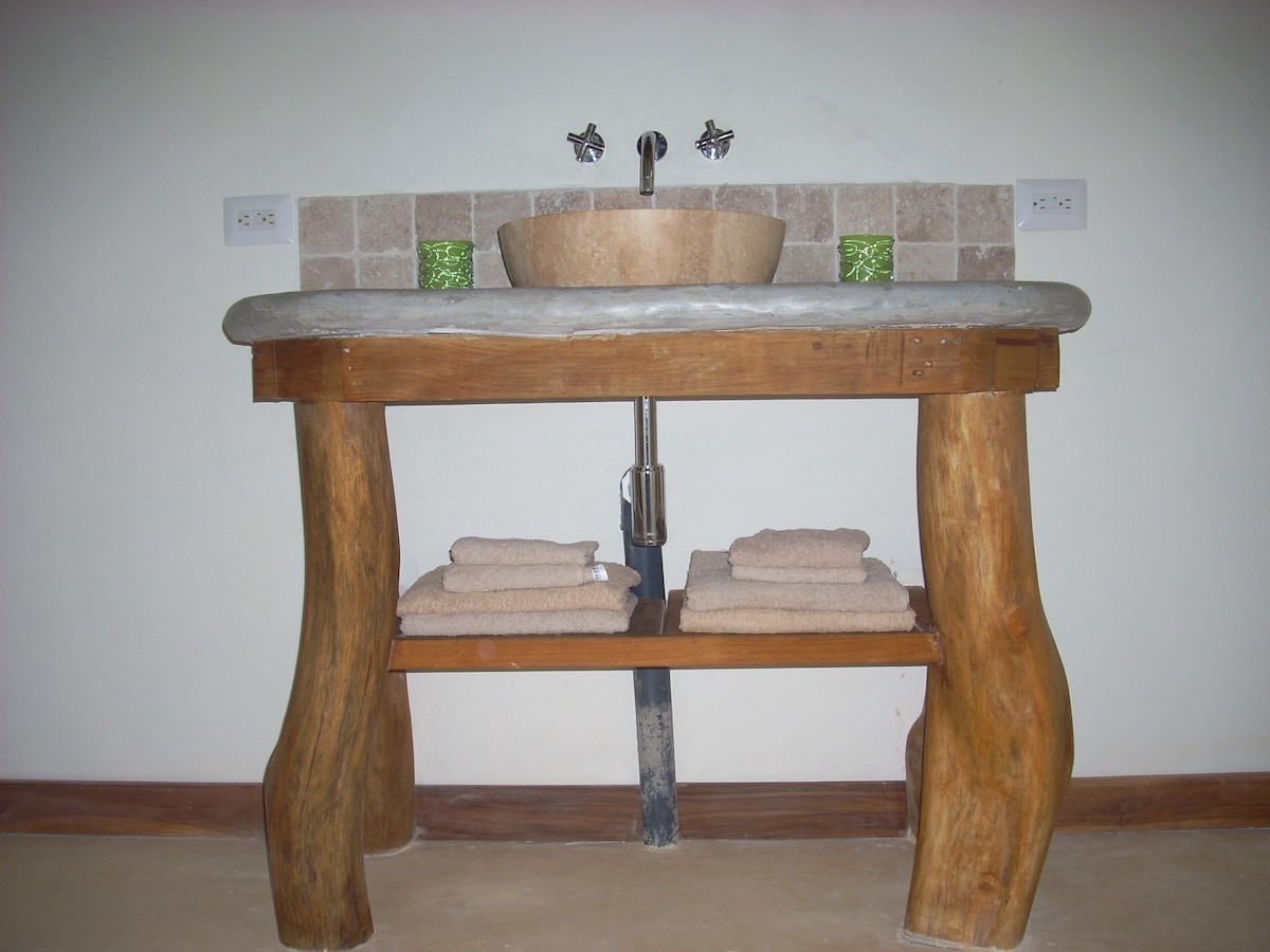 bathroom with hot water and laundry service available