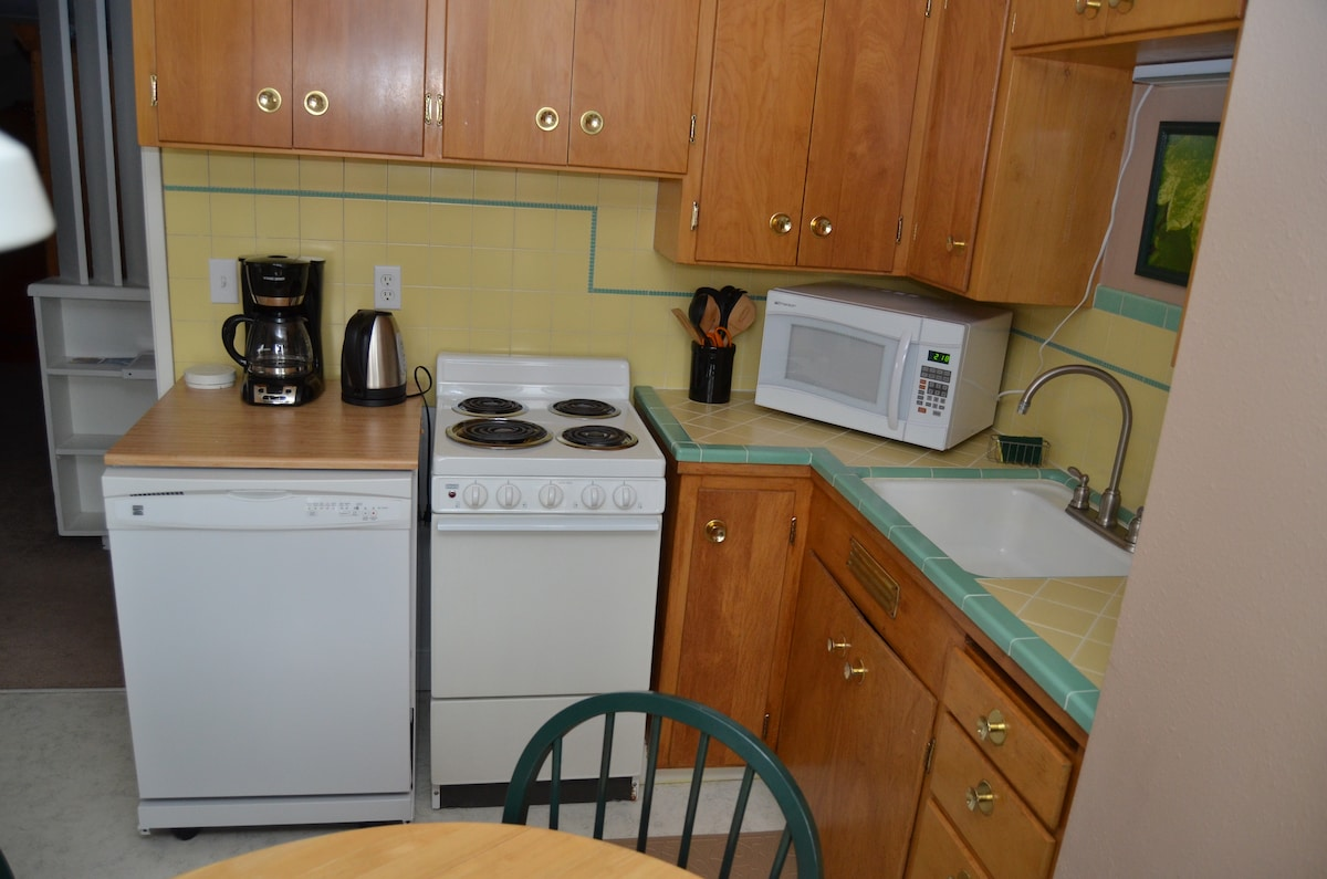 Kitchen is stocked with cookware, flatware and appliances so you can eat in if you choose.